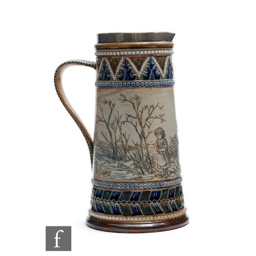 13 - A late 19th Century Doulton Lambeth jug decorated by Hannah Barlow with an incised band showing two ...
