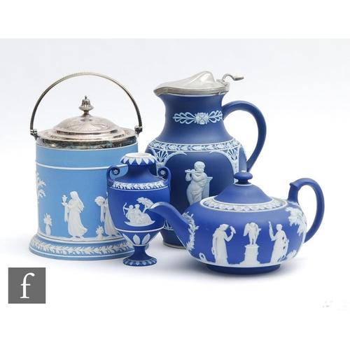 17 - Four pieces of late 19th to early 20th Century Wedgwood jasperware comprising a biscuit barrel, a sq...