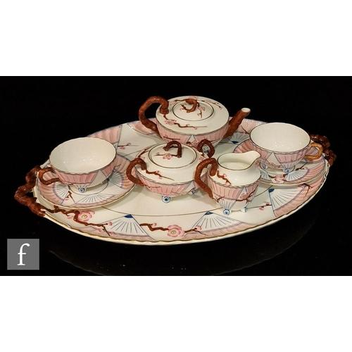 18 - A late 19th Century Wedgwood Aesthetic cabaret tete-a-tete set comprising squat teapot, milk jug, su...
