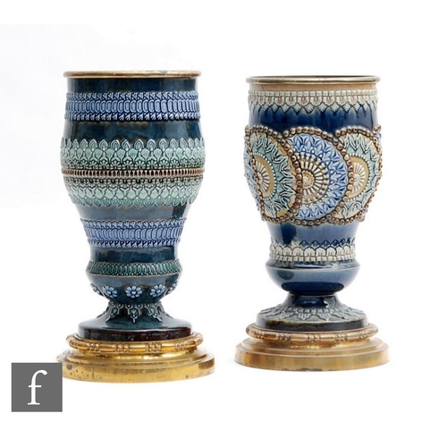20 - Two late 19th to early 20th Century Doulton Lambeth pedestal vases or oil lamp bases, each with rais...