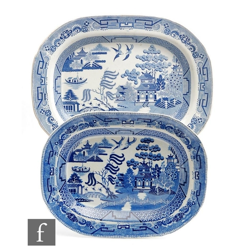 36 - Two 19th Century blue and white meat plates decorated in the Willow pattern, the largest stamped Gen...