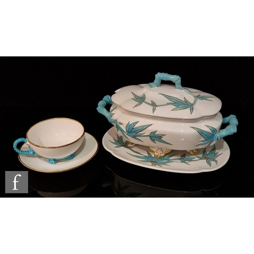 4 - A 19th Century Royal Worcester tureen, cover and stand in the Aesthetic style decorated with blue en...