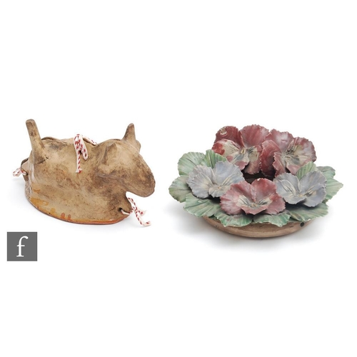 44 - An early 20th Century French two part mould modelled as a dog, the terracotta glazed to the interior...