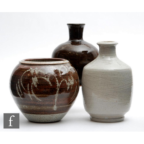 49 - Three pieces of 20th Century studio pottery comprising a bottle vase with combed detail to the neck ...