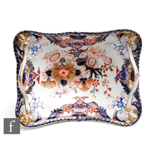 5 - A large 19th Century Derby rectangular twin handled comport or footed basket decorated in the Imari ...