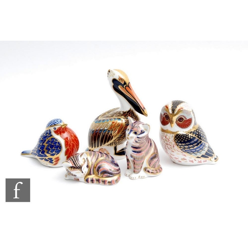 50 - Five assorted Royal Crown Derby paperweights comprising a Brown Pelican, a Tawny Owl, a robin, sleep...