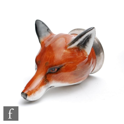 52 - A later 20th Century Bloor China stirrup cup formed as the head of a fox with a silver coloured meta...
