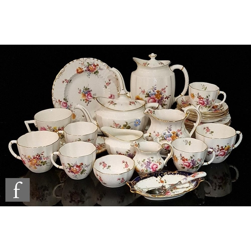 54 - A collection of Royal Crown Derby Derby Posies teawares comprising a coffee pot, a teapot, three bre...