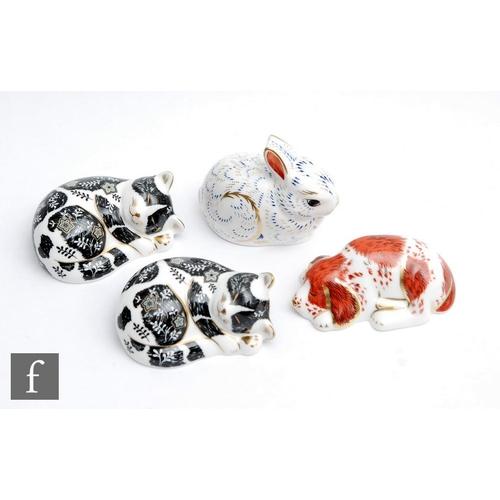 55 - Four boxed Royal Crown Derby Members Pack Collectors Guild paperweights comprising two Misty, one Bu...