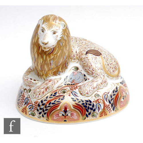 57 - A boxed Royal Crown Derby paperweight Lion, gold stopper.