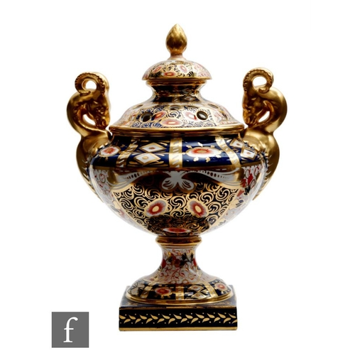6 - A large 19th Century Davenport pedestal vase and cover decorated in an all over Imari palette, patte...