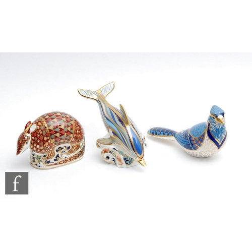 60 - Three boxed Royal Crown Derby paperweights comprising an Armadillo, Blue Jay and Striped Dolphin, al...