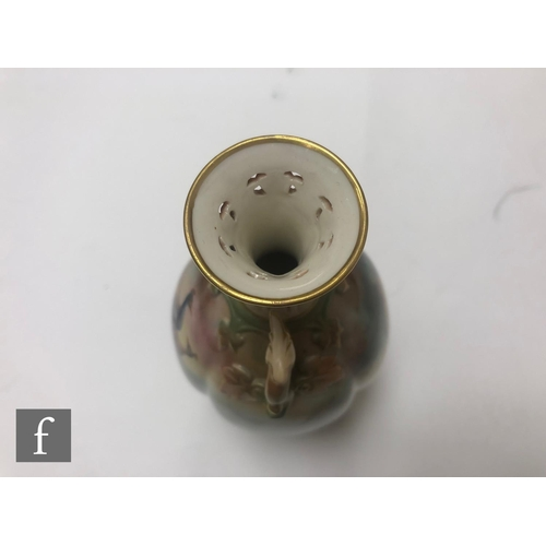 8 - An early 20th Century Royal Worcester vase of gourd form with an applied moulded foot and shaped han...