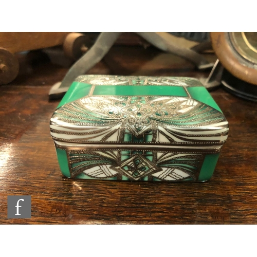 3 - A Noritake rectangular box and cover decorated in the Art Deco style with silver lustre decoration o...