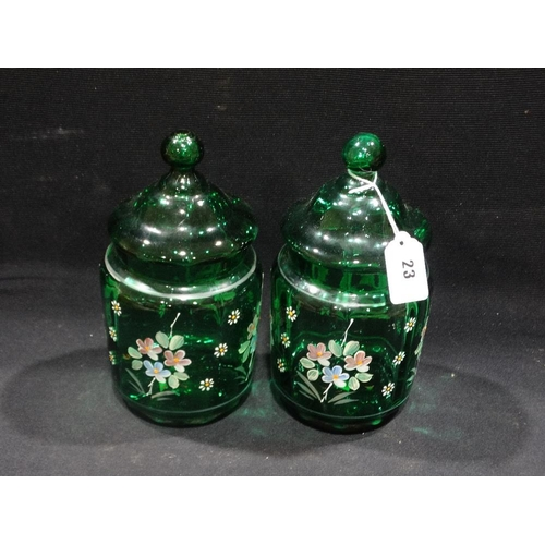 23 - A Pair Of Green Glass & Floral Painted Jars & Covers