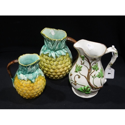 4 - Two Majolica Glazed Pineapple Jugs, Together With A Further Moulded Staffordshire Pottery Jug
