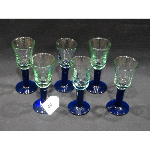 40 - A Group Of Six Blue Glass Stemmed Toasting Glasses