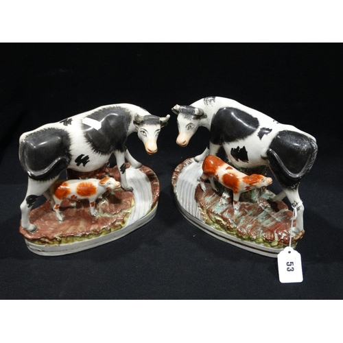 53 - A Pair Of Staffordshire Pottery Cow & Calf Groups