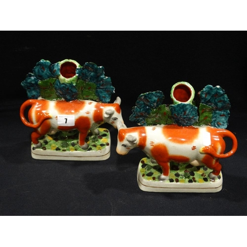 7 - A Pair Of Reproduction Staffordshire Pottery Cow Spill Holder Groups
