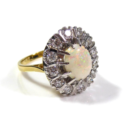 51a - AN 18CT GOLD, OPAL AND DIAMOND CLUSTER RING Having a cabochon cut opal edged with round cut diamonds...