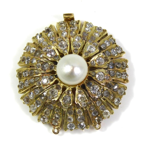 54a - AN 18CT GOLD, DIAMOND AND PEARL NECKLACE CLASP The single pearl edged with five rows of round cut di...