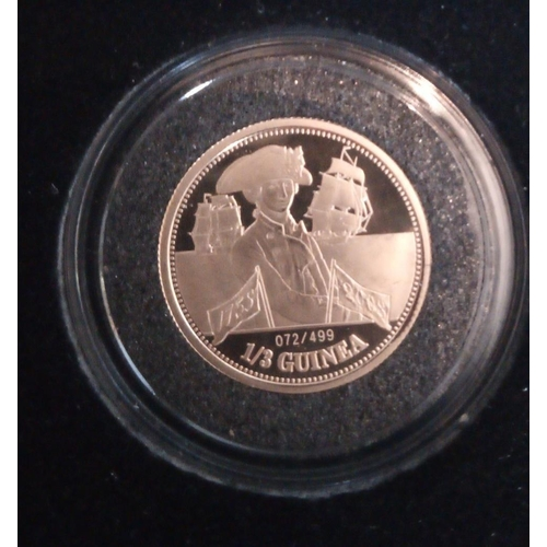 2a - A 24CT GOLD TRAFALGAR 1/3 GUINEA PROOF COIN, 2008, TRISTAN DA CUNHA In a protective capsule and fitt...