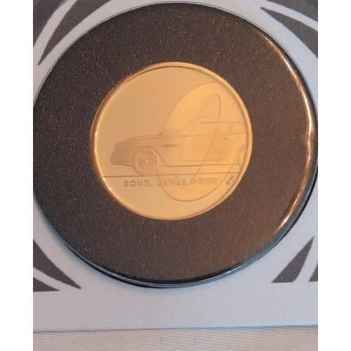 46 - A 24CT GOLD 1/4OZ JAMES BOND PROOF COIN COVER, DATED 2020  In a protective pouch, complete with cert...