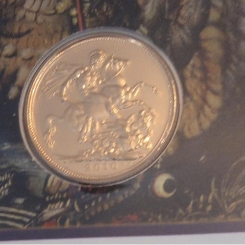 52 - A 22CT GOLD FULL SOVEREIGN PROOF COIN COVER, DATED 2010, ST. GEORGE AND DRAGON In a protective pouch...
