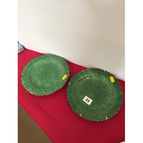 23 - TWO 19TH CENTURY GREEN LEAF PLATES...