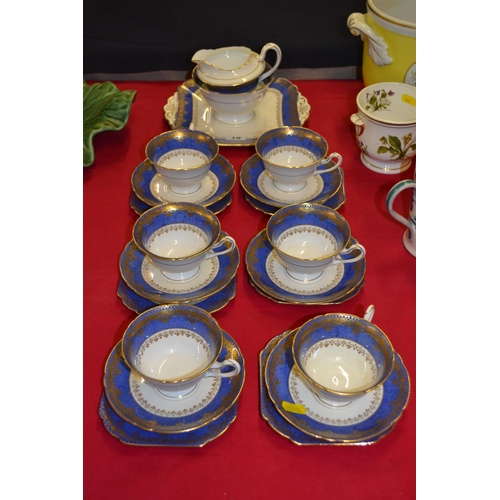 10 - SHELLEY WHITE, BLUE AND GILT TEA SERVICE (21 PIECES)...