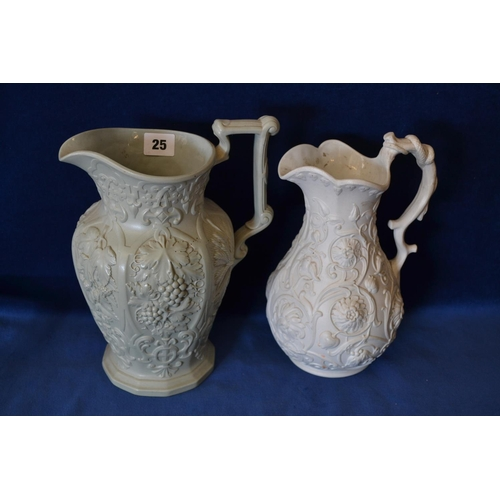 25 - TWO VICTORIAN EMBOSSED SILICON CHINA JUGS...