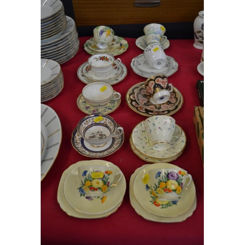 22 - SEVEN VARIOUS BONE CHINA TRIOS AND 3 CUPS AND SAUCERS...