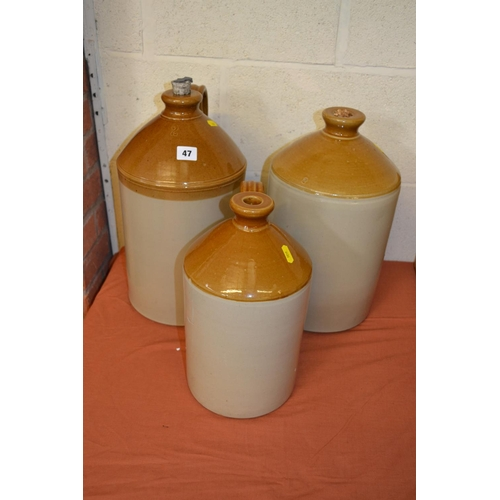 47 - TWO 2 GALLON STONEWARE 2 TONE BOTTLES AND ONE 1 GALLON STONEWARE 2 TONE BOTTLE...