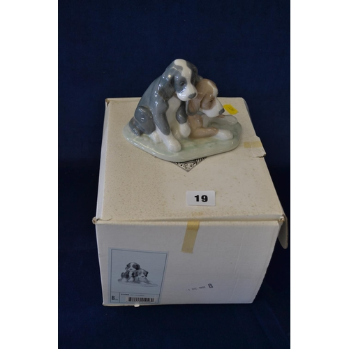 19 - NAO PORCELAIN GROUP OF TWO SPANIEL PUPS...