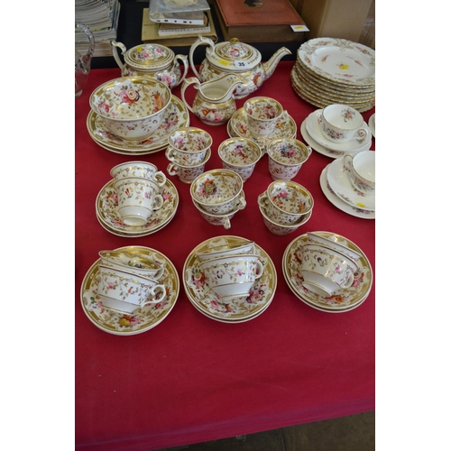 35 - 19TH CENTURY WHITE, GILT AND FLOWERED PART TEA SERVICE (35 PIECES)...