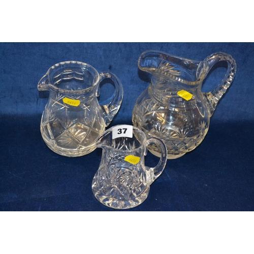 37 - 3 GRADUATED CUT GLASS JUGS...