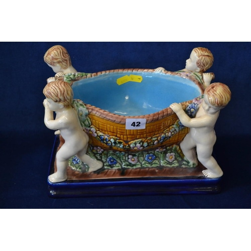 42 - BOAT SHAPED MAJOLICA BOWL DECORATED GARLANDS SUPPORTED BY FOUR PUTTI...