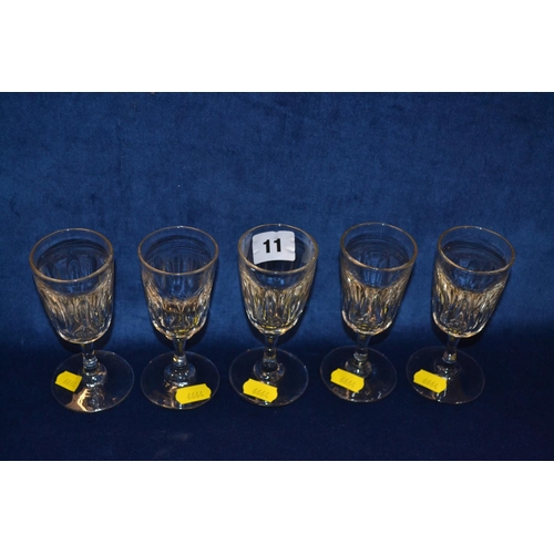 11 - FIVE 19TH CENTURY DRINKING GLASSES WITH FLUTED BOWLS ON CIRCULAR FEET...