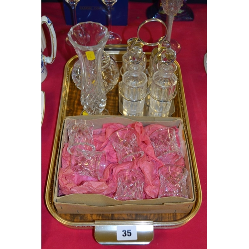 35 - FOUR BOTTLE CUT GLASS CONDIMENT SET ON SILVER PLATED STAND, 6 CUT GLASS NAPKIN RINGS, VASE AND ROSE ...