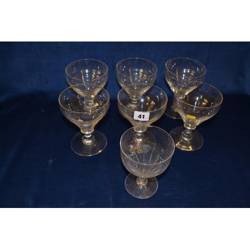 41 - SET OF SIX 18TH CENTURY GLASS RUMMERS ON CAPSTAN STEMS, ON CIRCULAR FEET AND ONE ODD ONE...