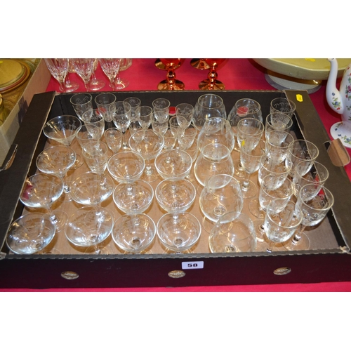58 - QUANTITY OF ETCHED GLASS DRINKING GLASSES...