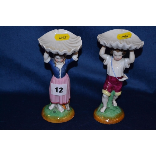 12 - PAIR OF 19TH CENTURY PORCELAIN FIGURES HOLDING BASKETS...