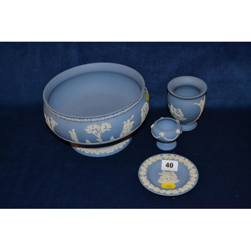 40 - FOUR PIECES OF WEDGWOOD BLUE AND WHITE JASPERWARE COMPRISING PEDESTAL FRUIT BOWL, VASE, PIN TRAY AND...