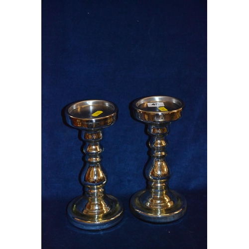 45 - PAIR OF SILVERED CHINA CANDLESTICKS (23CM)...