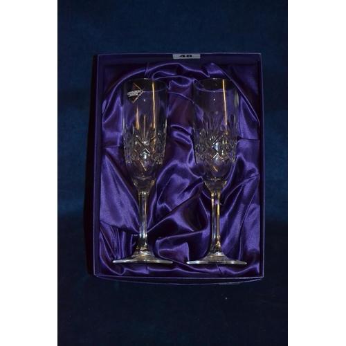 48 - PAIR OF EDINBURGH CRYSTAL GLASS CHAMPAGNES...