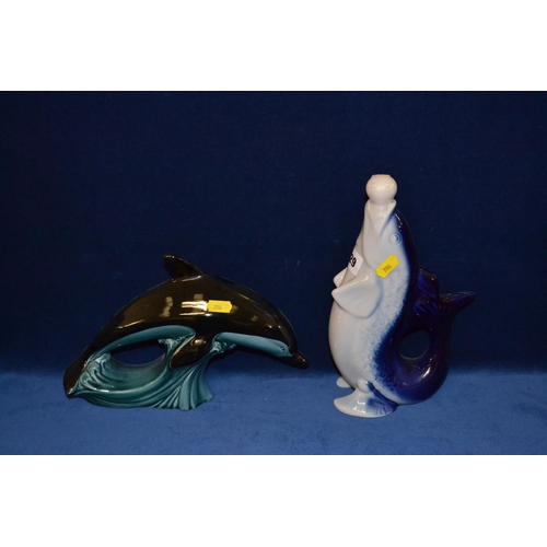 29 - LARGE POOLE (CARTER STABLER ADAMS) LEAPING DOLPHIN TOGETHER WITH PORCELAIN STYLISED FISH DECANTER