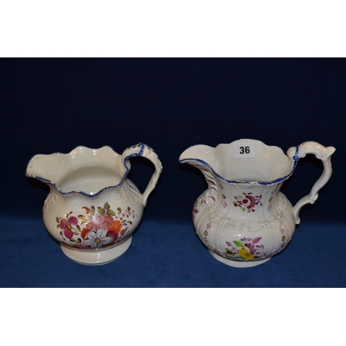 36 - TWO 19TH CENTURY BULBOUS RELIEF PATTERN JUGS HAND PAINTED FLOWERS