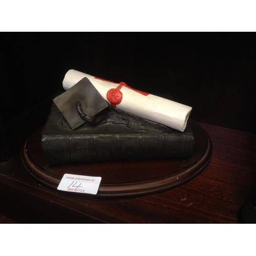 14 - Bronze scroll on mahogany base...