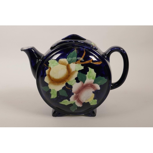 37 - A vintage Maling of Newcastle barrel pattern pottery teapot painted with flowers on a dark blue grou...