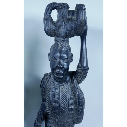 23 - Two African carved ebony figures, largest 17½